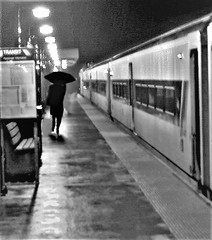 Wet and Cold (Videoal) Tags: raining umbrella commuter newjersey nighttime damp cold train njtransit