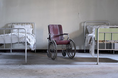 Manicomio di V (Explore) (Jonnie Lynn Lace) Tags: abandoned italy italia italian europe european trip travel hospital asylum insane manicomio wheelchair chair bed beds bedroom room medical institution decay derelict detail details white yellow red texture textures d750 nikkor nikon 50mm digital light day daylight sunlight shadows bright peelingpaint old classic history exploration explore urbex memories time ruins