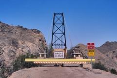 bridge to nowhere. yuma, az. 2018. (eyetwist) Tags: eyetwistkevinballuff eyetwist bridge abandoned yuma arizona desert gilariver nikon n90s nikkor 28105mmf3545d fuji velvia 50 rvp transparency chrome slide nikonn90s fujivelvia50rvp ishootfilm ishootfuji analog analogue film emulsion coolscan iconla bridgetonowhere us95 sonorandesert southwest usa road trip decay ruin closed mcphaul suspension iron roadclosed sign signs notrespassing caution bees warning sting tower 35mm bridgeout landscape highway barrier butterfieldstage 28105mm
