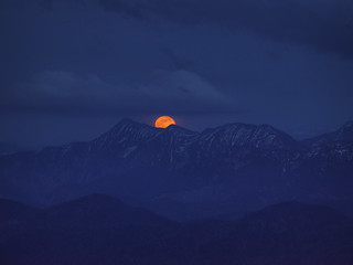 Full moon rising over the bavarian alps