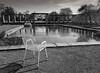 emptiness (FotoTrenz NRW) Tags: chair emptiness park pool garden water blackandwhite bnw bw monochrome shadow düsseldorf nordpark nrw
