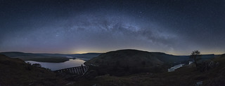Views of the Milkyway arching over Craig Goch Dam with faint Aurora also visible