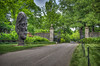 The large head is keeping watch over the entrance. (donnieking1811) Tags: tennessee nashville cheekwoodbotanicalgardenandmuseumofart cheekwood gardens trees entrance gate sculpture sky clouds street art museum hdr 60d canon lightroom photomatixpro signs