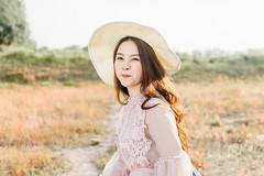 DSC_0180 (tungson.nguyen) Tags: girl woman vietnamese hat backlit dress film portrait sunshine grass