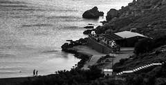 By the sea, after sunset (kurjuz) Tags: ghajntuffieha malta aftersunset blackandwhite dusk ripples rocks sea seasiderestaurant walkingbythesea