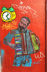 Accordion player (david ross smith) Tags: paris france graffiti art text ad poster sticker sign signage pigalle 18tharr 18tharrondissement