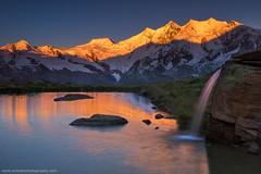 Bright Start @ Kreuzboden, Switzerland (Avisekh) Tags: swiss switzerland saasfee kreuzboden lake waterfall alps sunrise tripod wwwavisekhphotographycom nikon d810 2470 leefilters gnd polarizer early goldenhour