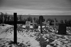 Cold Rest (1sock) Tags: iceland snow blackandwhite landscape cross cemetery water ice white black mountains