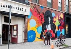 Joey Ramone (UrbanphotoZ) Tags: joeyramone saxonparole streetart urbanart friends restaurant mural cbgb theramones boxinggloves bike splatter sp redbrick wall column apartmentbuilding noho manhattan newyorkcity newyork nyc ny