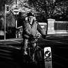 Going Gnome (Kieron Ellis) Tags: man road trees bridge street candid blackandwhite blackwhite monochrome hat glasses