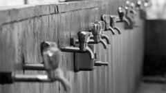 water taps (ToDoe) Tags: wasser water freshwater reinigung mountedinserieswitheachother bw schwarzweis schwarzweiss monochrome dof bokeh hahn wasserhähne wasserhahn seifenspender unregelmäsig