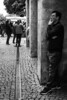 Thoughtful (Isengardt) Tags: thought gedanke denken think thoughtful gedankenvoll vollergedanken anlehnen lean pfosten säule column line linie marktplatz market marketplace flohmarkt trödelmarkt black white schwarz weiss monochrome monochrom bw sw street strase nachdenken thinking stuttgart badenwürttemberg deutschland germany europe europa olympus omd em1 1250mm