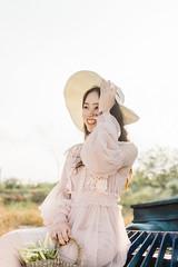 DSC_0190 (tungson.nguyen) Tags: girl woman vietnamese hat backlit dress film portrait sunshine grass