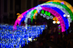 Christmas lights surrounding the Chanthaburi Cathedral. (baddoguy) Tags: aerial view art product bright built structure celebration christianity christmas decoration lights ornament tree closeup color image colored background concepts copy space crowd cultures curve defocused fantasy happiness high angle horizontal ideas igniting illuminated lens flare light effect majestic multi night outdoors people photography side thai culture thailand tradition traditional festival travel destinations tunnel