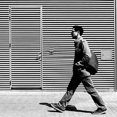 In front of the wall door (pascalcolin1) Tags: paris13 homme man mur wall porte portemurale walldoor sac bag photoderue streetview urbanarte noiretblanc blackandwhite photopascalcolin canon50mm 5omm canon