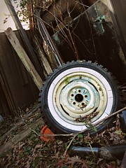 Behind the fence (Dave* Seven One) Tags: rusty used broken dirty tire tyre whitewall fence trespassing snowtire junk abandoned forgotten