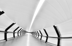 The New Icon - Adams Plaza Bridge - A Brand New World Canary Wharf by Simon Hadleigh-Sparks (Simon Hadleigh-Sparks) Tags: symmetry lines light architecture london city canarywharf tunnel abstract corridor contrast composition geometric iconic pattern simonandhiscamera urban explore bw blackandwhite monochrome 360 black white