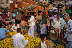 Fruit market (SaumalyaGhosh.com) Tags: fruits fruit people market kolkata india street streetphotography color colors orange basket truck menatwork crowd