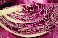 A Slice of Life (PDX Bailey) Tags: purple cabbage vegetable food glistening mist droplet grocery store close slice half display department