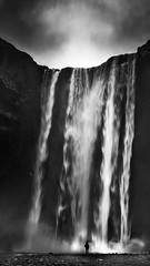 Skogafoss (Des Daly) Tags: iceland waterfall person scale size monochrome large river mountain