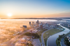 Aerial view of Vilnius new high rise district with fog in the morning (spot-on.lt) Tags: grass spring landscape bridge scrub landmark cityscape panorama goldenhour water clouds lithuania morning trees skyscraper road hills river tower car sky vilnius fog sunny europe drone sunrise travel above aerial architecture building capital city field hill sunshine transportation vehicle