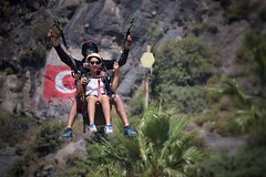 Incoming (leewoods106) Tags: oludeniz turkey paragliding gopro people person flying landing mustseeplaces trip vacation holiday holidays traveling traveler travel asia europe flag red photographer photography photo photos canonefs55250mmstm canoneos77d