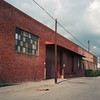 Industrial trapezoid (ADMurr) Tags: la eastside east los angeles industrial poles bricks windows pavement tarmac rolleiflex 35 e kodak portra film mf 6x6 2016 ccc988