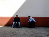 Two kinds (A. Yousuf Kurniawan) Tags: shade shadow minimalism minimalist colourstreetphotography streetphotography wall people duo decisivemoment two blur