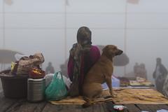 At Varanasi (Ravikanth K) Tags: 500px dog pet winter warm seller people ghat fog morning travel street outdoor weather warmth cold varanasi kasi india cwc cwc623 chennaiweekendclickers leaning lady woman