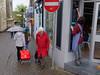oriau agor (watcher330) Tags: carmarthen woman sign pedestrians umbrellas