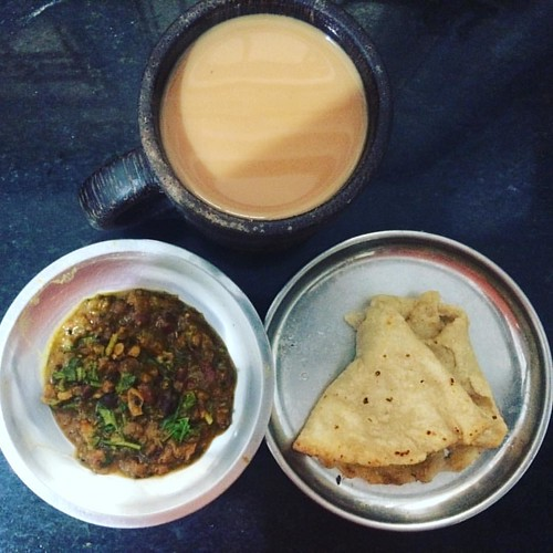 Trying to eat healthy and eat enough and not gain weight. This is #sorghum / #jowar #roti, with (#chana/ #rajam #greengram #masala) #lentil #stew , with big #mug or #jar of tea in a #coconut #wood mug ( a new favourite , we bought from #thailand ). #food