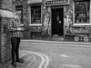Northern Quarter 234 (Peter.Bartlett) Tags: manchester niksilverefex art unitedkingdom window people wall city graffiti olympuspenf monochrome streetphotography cellphone doubleyellowlines peterbartlett man urban noiretblanc candid uk m43 microfourthirds mobilephone bw door sign blackandwhite facade corner england gb
