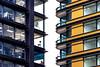 Zip (DobingDesign) Tags: architecture balconies glass windows floors storeys nextdoor adjacent opposite jagged angles lines modernarchitecture geometric angular pattern furniture flipcharts hatrack lookingup asymmetric negativespace zigzag