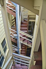 Borrowed From Escher? (sswj) Tags: escher mauritscornelisescher scottjohnson stairs stairway woodstairs oldbuilding apartmentbuilding backstairs composition availablelight naturallight existinglight leica dlux4 sanfrancisco northerncalifornia abstractreality