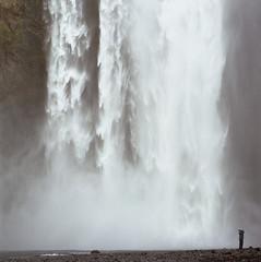 Shape of a Moment (Kippy!) Tags: hasselblad500c iceland skogafoss waterfall water spray rocks person ground stream white kodakportra400 mediumformat 120 squareformat c41
