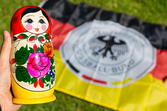 Babushka doll and German flag (marcoverch) Tags: fusball trohpy fusballwm titelverteidigung souvenir moskau schwarzrotgold weltmeisterschafft germany titel weltmeister football russland2018 wm2018 deutschland babushka doll german flag symbol desktop color farbe fun spas noperson keineperson summer sommer toy spielzeug celebration feier illustration design art kunst nature natur castle españa windows airport style rose event streetart lowkey outside