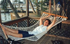 At ease in the Keys (BarryFackler) Tags: bettyfackler bettybowen betty vacation trip fun 1995 floridakeys florida monroecounty hammock relaxing palmtrees palms tropical smiling outdoor smile gulfofmexico sea saltwater island pier dock marine aquatic amyslatesamoraydiveresort keylargo thekeys people