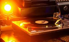 Révolution. (Canad Adry) Tags: sony e kit lens sel 1855 alpha mount zoom vinyle music light orange spot flash night dj musician platine sound cd vinyl