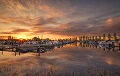 Marina Gold (Captain Nikon) Tags: sunrise sawley sawleymarina leicestershire marina boats reflections golden goldenhours derbyshire sunburst nikon nikond7000 sigma1020mmf4 srbneutraldensitygraduated06filter outdoorphotography landscapephotography