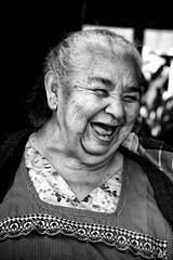 She is rich of his smile ! (poupette1957) Tags: art atmosphère black canon city curious costumes guatemala antigua humanisme humour imagesingulières life lady monochrome noiretblanc noir old photographie people portrait rue street town travel ville voyage smile