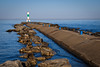 A Walk Along the Pier (joshuay04) Tags: holland michigan fuji xh1 lakemichigan lighthouse harbor statepark morning goldenhour calm peaceful rocks blue sky sunrise