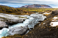 Stream of Wonder (Mikko Manner) Tags: nikon nikond7200 sigma sigma1835mmf18art iceland travel roadtrip 2018 stream water river flow mountains mountainscape snow view vista landscape rock rocks bluewater dramaticclouds grass volcanic pond wonder beautiful breathtaking detail colourful colours harsh nature natural turquoise wet reflections tripod adobelightroom photography polarisingfilter filter scenery scenic scenicview sky clouds amazing texture cold vegetation