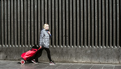 The red shopper (phil anker) Tags: people street london kingscross