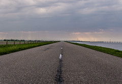 The long empty road (Marco van Beek) Tags: road empty landscape sky clouds nature grass fence dike water holland europe beautiful world nikon d5000 afs dx nikkor 18200mm f3556g ed vr ii