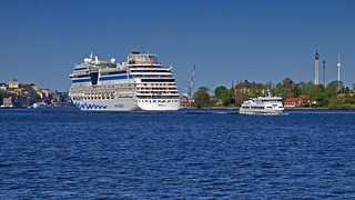 The cruise ship AIDAmar arriving in Stockholm, meets the archipelago boat Viberö