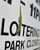 Loitering Lizard (steveboer.com) Tags: gecko lizard sign loitering park hawaii text street font word animal black reptile sitting alphabet nature white summer green