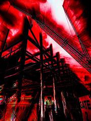 Entering Hell's Gate 2 (Steve Taylor (Photography)) Tags: gate hell digitalart crane construction fence chainlink black red white monocolor monocolour stark contrast metal newzealand nz southisland canterbury christchurch cbd city blur lines texture heat