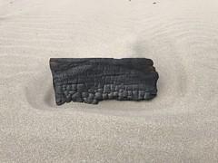 Zoghal! (RaminN) Tags: wood burnt driftwood beach coal sand