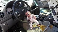 When evil dolls steal the family car... (tishpitt1) Tags: doll evil possessed evildoll artdoll car jeep wreck accident junk junkyard panasoniclx7
