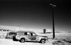 1335 (The Dent.) Tags: kodakhawkeyesurveillancefilm south australia coober pedy tmx dev 19 10 mins 2485 analogphotography nikon f100 24mm red filter desert outback wreckage